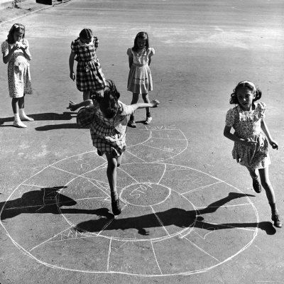 Girls Playing Hopscotch in the Street Stretched Canvas Print