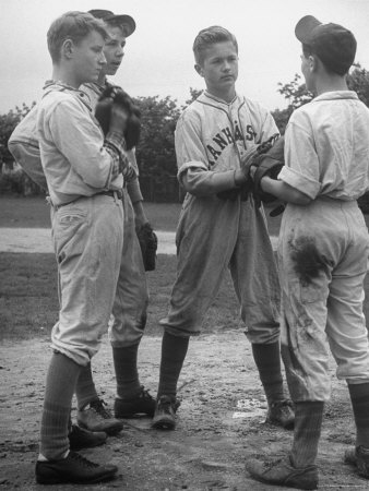 Boys Having a Discussion Before Playing Baseball Stretched Canvas Print