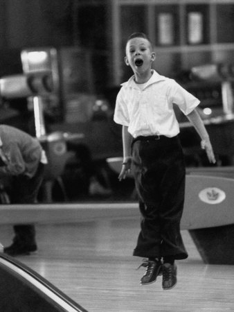 Child Bowling at a Local Bowling Alley Stretched Canvas Print