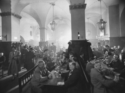 Interior of Munich Beer Hall, People Sitting at Long Tables, Toasting Stretched Canvas Print