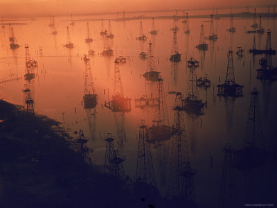 Oil Rigs Dating from the 1920's Dot the Shallows of Galveston Bay Stretched Canvas Print