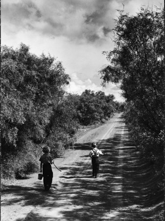 Two Children Walking Down a Dirt Road Going Fishing on a Summer Day Stretched Canvas Print