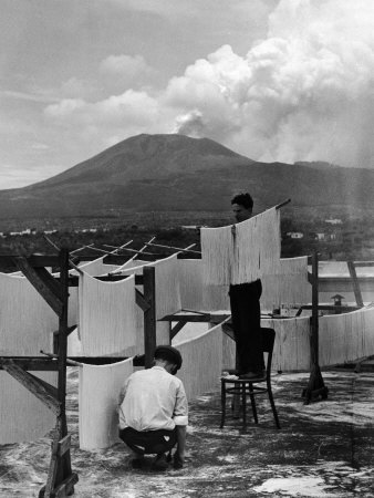 View of Mount Vesuvius from the Town of Torre Annunciata with Men Tending to Drying Pasta Stretched Canvas Print