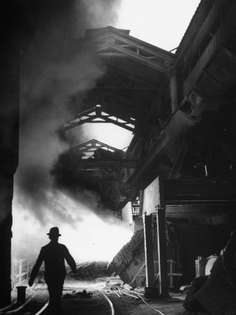 Man Walking in the Smokey Steel Mill Stretched Canvas Print