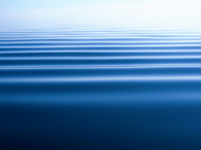 Small Gentle Ripples Move Across the Calm Surface of the Arctic Ocean Stretched Canvas Print