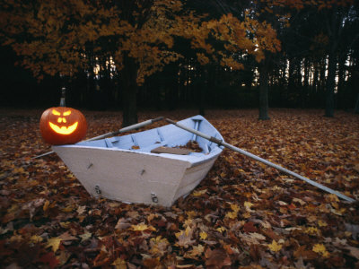 An Illuminated Jack-O-Lantern on the Back of a Rowboat Stretched Canvas Print