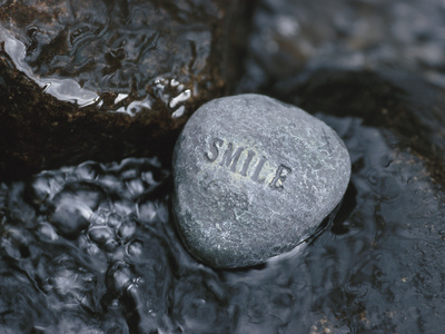 Rock with the Word Smile in Rushing Water Stretched Canvas Print