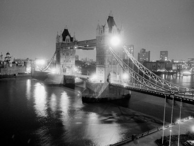 A View of Tower Bridge on the River Thames Illuminated at Night in London, April 1987 Stretched Canvas Print