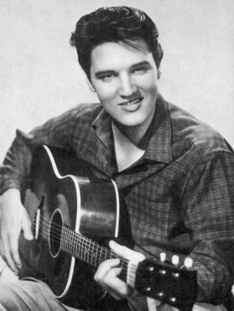 Elvis Presley American Pop Singer Guitarist and Actor in Musical Films Seen Here with His Guitar Stretched Canvas Print
