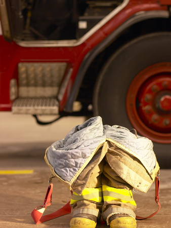 Firefighting Gear with Truck in Background Stretched Canvas Print