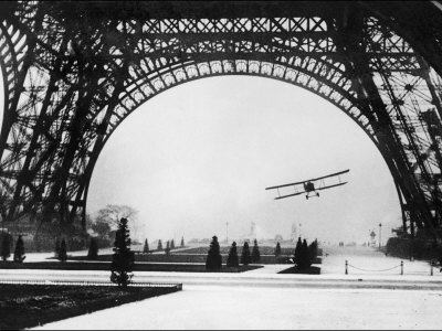 French Aviator Lieutenant Collot Successfully Flies His Biplane Beneath the Tour Eiffel Stretched Canvas Print