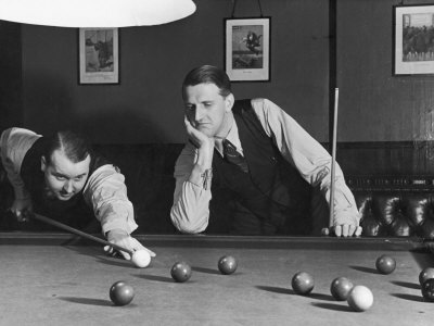 Snooker Player Prepares to Play a Shot as His Partner Looks On Stretched Canvas Print