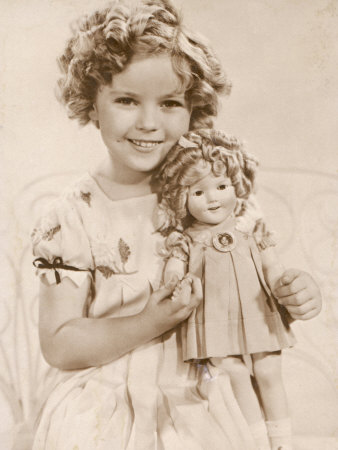 Shirley Temple American Child Star of the 1930s Seen Here with a Shirley Temple Doll Stretched Canvas Print