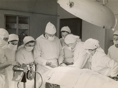 Group of Student Nurses in Theatre Observing a Surgeon Performing an Operation Stretched Canvas Print