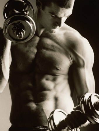 Close-up of a Young Man Working Out with Dumbbells Stretched Canvas Print