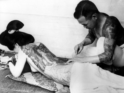 An Unidentified Japanese Tattoo Artist Works on a Woman's Backside Stretched Canvas Print