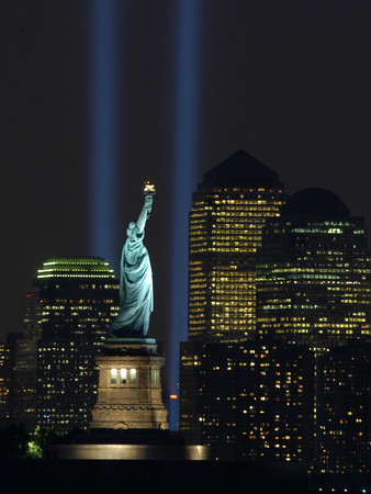 Lights from the Former World Trade Center Site Can be Seen on Both Sides of the Statue of Liberty Stretched Canvas Print