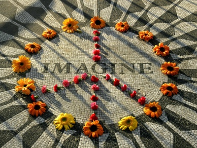 A Makeshift Peace Sign of Flowers Lies on Top John Lennon's Strawberry Fields Memorial Stretched Canvas Print