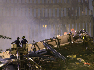 Two New York Firefighters View the Smoldering Rubble Stretched Canvas Print
