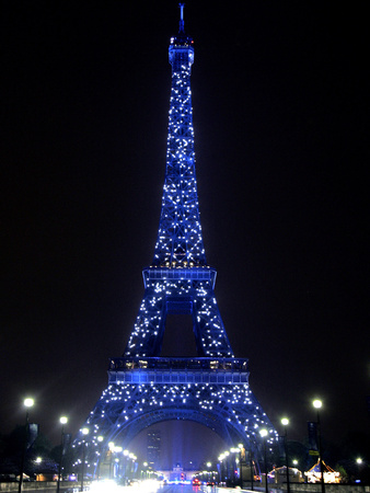 The Eiffel Tower Shows Blue Lighting to Mark Europe's Day Stretched Canvas Print