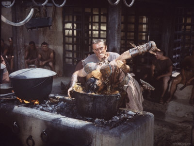 "Kirk Douglas Dunking Enemy's Head in Giant Cook Pot in Scene From Stanley Kubrick's ""Spartacus"" Stretched Canvas Print"