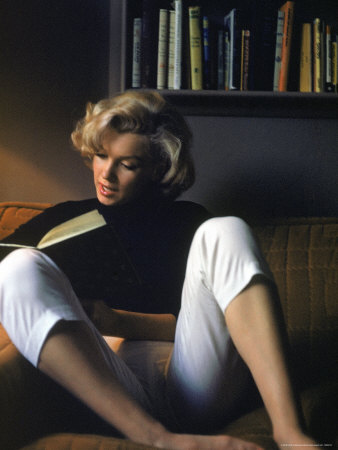 Marilyn Monroe Reading at Home Stretched Canvas Print