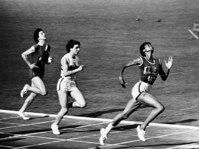 US Runner Wilma Rudolph Winning Women's 100 Meter Race at Olympics Stretched Canvas Print