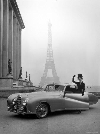 Model Wearing Jacques Fath Ensemble Beside 1947 Model Delahaye Automobile Stretched Canvas Print