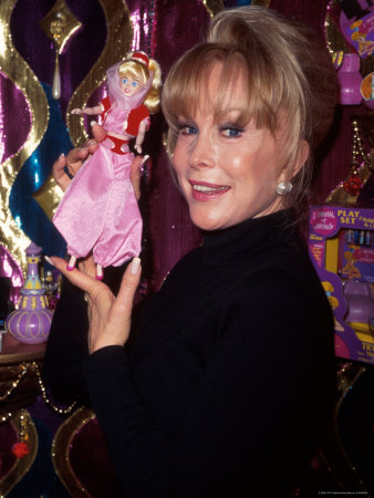 Actress Barbara Eden Holding Up Jeannie Doll Stretched Canvas Print