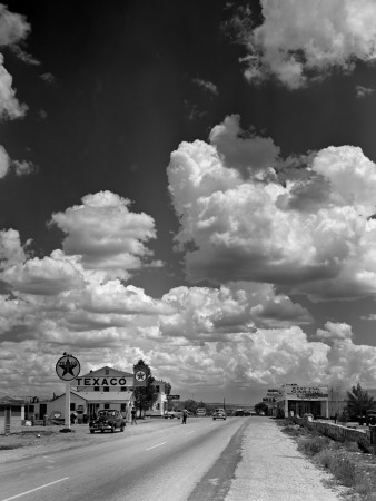 Cumulus Clouds Billowing over Texaco Gas Station along a Stretch of Highway US 66 Stretched Canvas Print