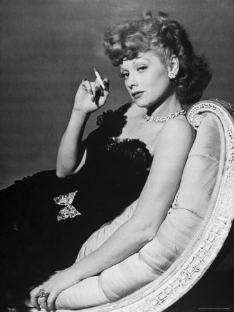 Dancer/Actress Lucille Ball in Strapless Black Lace Evening Dress, Holding Lit Cigarette on Couch Stretched Canvas Print