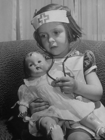 Evelyn Mott playing Nurse with doll as parents adjust children to abnormal conditions in wartime Stretched Canvas Print
