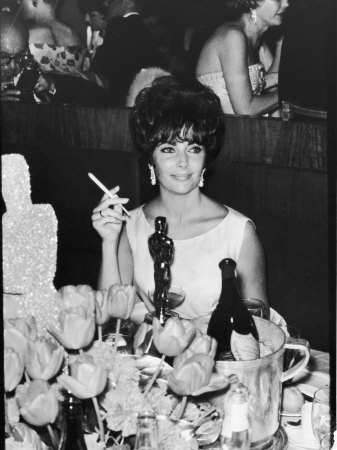Actress Elizabeth Taylor at Hollywood Party After Winning Oscar, Which is on Table in Front of Her Stretched Canvas Print