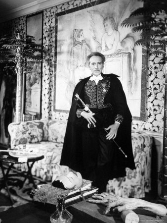 Poet and Filmmaker Jean Cocteau Dressed in Uniform of Academie Francaise, Holding Sword He Designed Stretched Canvas Print