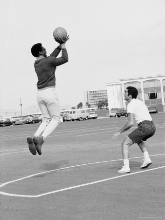 Comedian Bill Cosby Shooting Ball Against His Press Agent, Joe Sutton, During Game of Basketball Stretched Canvas Print