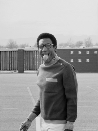 Comedian Bill Cosby Sticking His Tongue Out During Game of Basketball Stretched Canvas Print