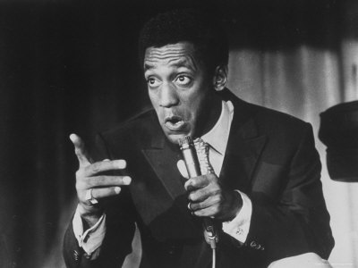 Comedian Bill Cosby Holding Mike as He Performs on Stage Stretched Canvas Print