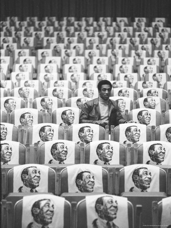 Comedian Bill Cosby Sitting in Empty Auditorium Filled with Copies of His Likeness on Each Seat Stretched Canvas Print