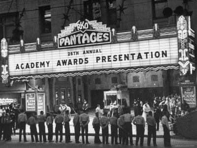 Attendants in Front of Pantages Theater Await Celebrities to Arrive for 26th Annual Academy Awards Stretched Canvas Print