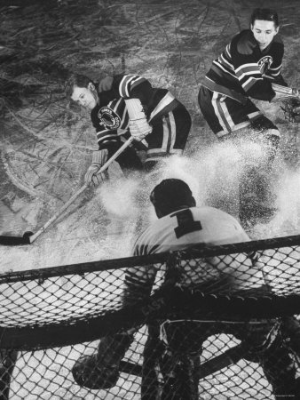 Ice Hockey Players Bill Mosienko and Max Bentley Making a Play Against the Goalie Stretched Canvas Print