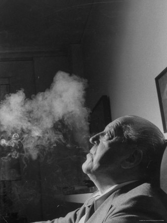 Portrait of Architect Mies Van Der Rohe Exhaling Smoke Stretched Canvas Print