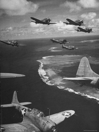 Squadron of US Douglas SBD3 Dive Bombers in Flight, Patrolling Coral Reefs Off Midway Island Stretched Canvas Print