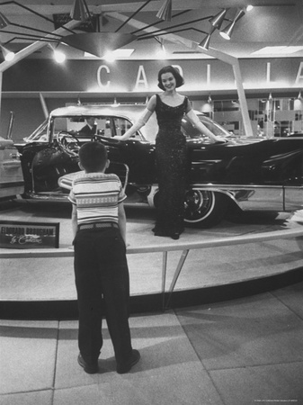 Model Posing Beside Cadillac Eldorado Captures Attention of Young Boy at National Automobile Show Stretched Canvas Print