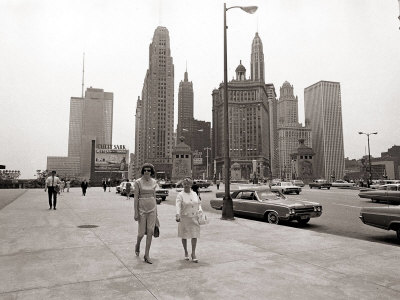Two Ladies Walking the Sidewalk Skyscrapers in Chicago America's Windy City, in the 1960s Stretched Canvas Print