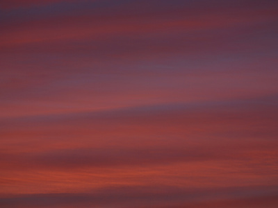 A Deep Red and Purple Sunset Stretched Canvas Print