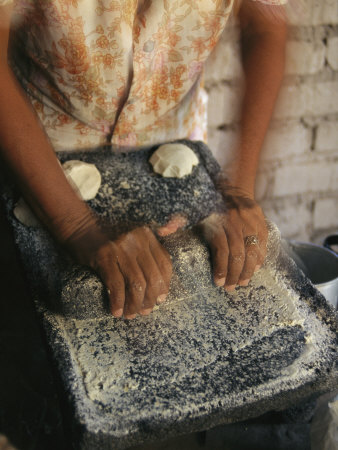 A Cora Woman Grinds Corn for Tortillas Stretched Canvas Print