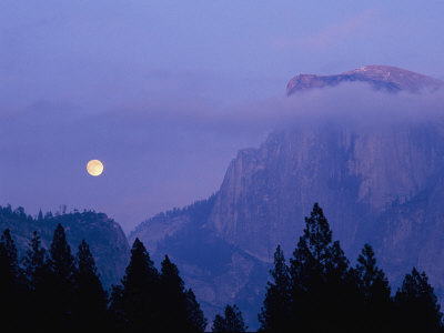 The Moon Rises over Half Dome in Yosemite National Park Stretched Canvas Print