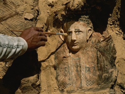 An Archeologist Brushes Dirt from the Mummy of a Child Stretched Canvas Print