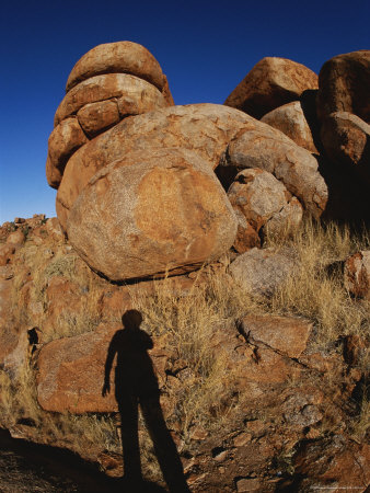 A Human Shadow is Projected onto One of the Devils Marbles Stretched Canvas Print