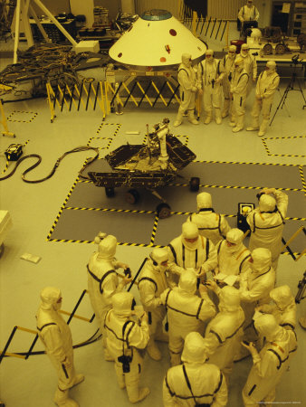 Journalists, Engineers and Technicians Examine a Robot in a Clean Room Stretched Canvas Print